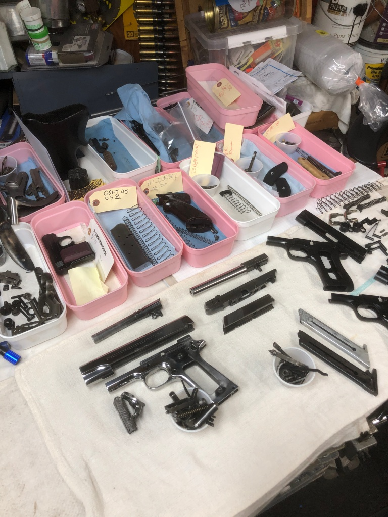 Pistols ready in line for bluing